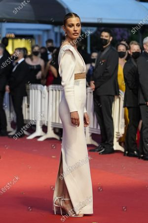 Sveva Alviti poses for photographers upon arrival at the premiere of the film 'Titane' at the 74th international film festival, Cannes, southern France