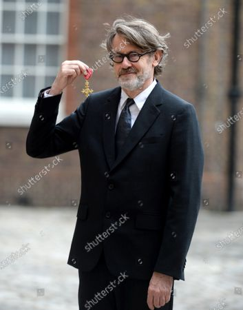 Stock Image of Author and cook Nigel Slater receives his OBE for services to Cookery and to Literature at St James's Palace London