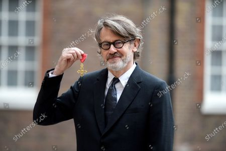 Author and cook Nigel Slater receives his OBE for services to Cookery and to Literature at St James's Palace London