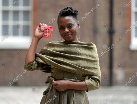 Stock Image of Actress Natasha Gordon shows her MBE for services to Drama at St James's Palace London