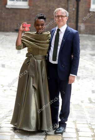 Actress Natasha Gordon shows her MBE for services to Drama at St James's Palace London