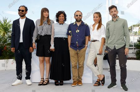 Stock Image of Sameh Alaa, Alice Winocour, Kaouther Ben Hania, Nicolas Pariser, Tuva Novotny and Carlos Muguiro pose during a photocall for the Cinefondation Jury at the 74th annual Cannes Film Festival, in Cannes, France, 14 July 2021. The movie is presented in the Official Competition of the festival which runs from 06 to 17 July.