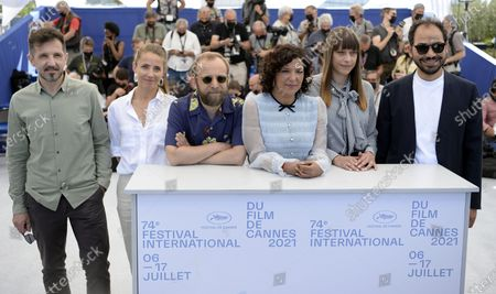 Carlos Muguiro, Tuva Novotny, Nicolas Pariser, Kaouther Ben Hania, Alice Winocour, and Sameh Alaa pose during a photocall for the Cinefondation Jury at the 74th annual Cannes Film Festival, in Cannes, France, 14 July 2021. The festival runs from 06 to 17 July.