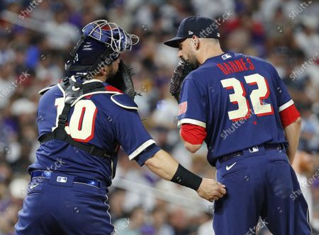 Boston Red Sox relief pitcher Matt Barnes (R) talks with Tampa Bay Rays catcher Mike Zunino in the seventh inning of the 2021 MLB All-Star Game at Coors Field in Denver, Colorado, on Tuesday, July 13, 2021.