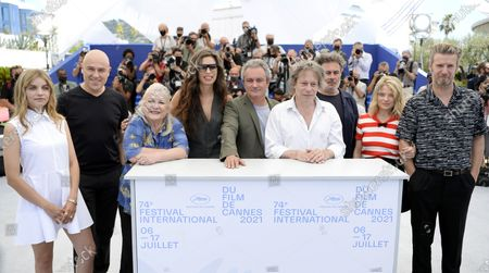 Galatea Bellugi, Dominique A, Josiane Balasko, Maiwenn, Jean-Marie Larrieu, Mathieu Amalric, Arnaud Larrieu, Melanie Thierry and Bertrand Belin pose during the photocall for 'Tralala' at the 74th annual Cannes Film Festival, in Cannes, France, 14 July 2021. The festival runs from 06 to 17 July.