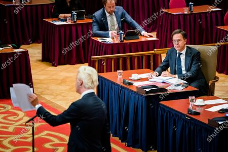 Geert Wilders (PVV) and outgoing Prime Minister Mark Rutte during a debate about the coronavirus in the Ridderzaal, in the Hague, Netherlands, 14 July 2021. The House of Representatives is back from recess due to the rapid increase in coronavirus infections.