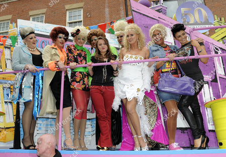 Vicky Binns, Beverley Callard and Kym Marsh with drag queens on the Coronation Street 50th Anniversary float