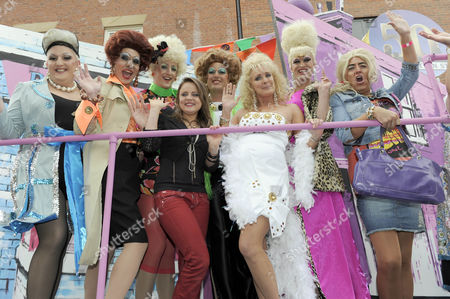 Vicky Binns and Beverley Callard with drag queens on the Coronation Street 50th Anniversary float