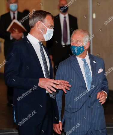Prince Charles walks next to Richard Gnodde, International CEO of Goldman Sachs, at the Goldman Sachs HQ in London, Britain, July 14, 2021.