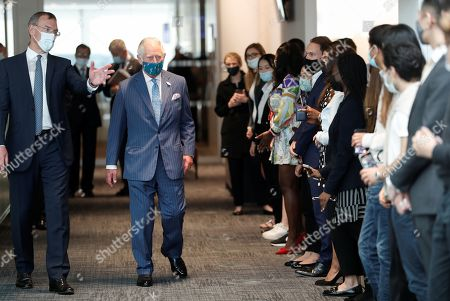 Prince Charles walks next to Richard Gnodde, International CEO of Goldman Sachs, as he meets traders at the Goldman Sachs HQ in London, Britain, July 14, 2021.