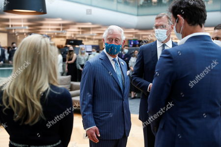 Prince Charles stands next to Richard Gnodde, International CEO of Goldman Sachs, as he visits the Goldman Sachs HQ in London