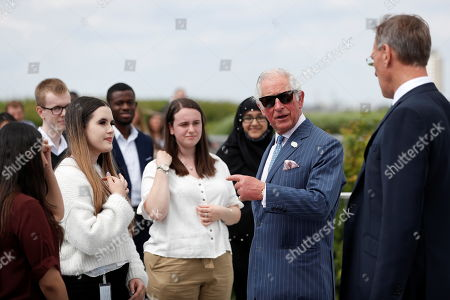 Stock Image of Prince Charles stands next to Richard Gnodde, International CEO of Goldman Sachs, as he visits the Goldman Sachs HQ in London