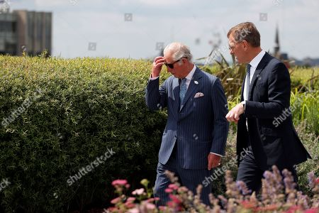 Prince Charles walks with Richard Gnodde, International CEO of Goldman Sachs, as he visits the Goldman Sachs HQ in London, Britain, July 14, 2021.