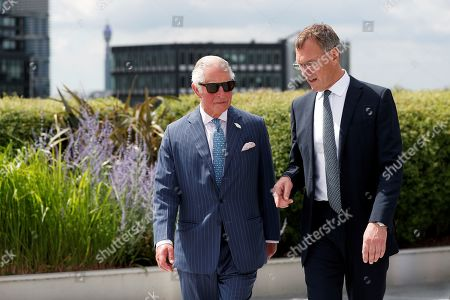 Stock Picture of Prince Charles walks with Richard Gnodde, International CEO of Goldman Sachs, as he visits the Goldman Sachs HQ in London, Britain, July 14, 2021.