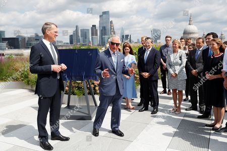 Prince Charles stands next to Richard Gnodde, International CEO of Goldman Sachs, as he visits the Goldman Sachs HQ in London, Britain, July 14, 2021.