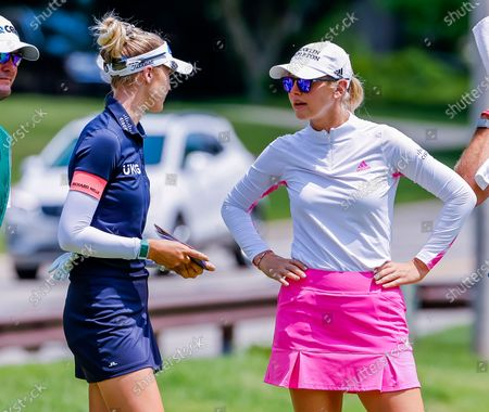 Sisters Nelly Korda (L) of the US and Jessica Korda (R) of the US on the second hole during the first round of the Dow Great Lakes Bay Invitational women's golf tournament at the Midland Country Club in Midland, Michigan, USA, 14 July 2021.