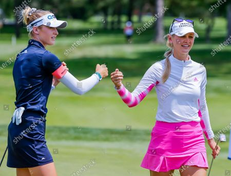 Sisters Nelly Korda (L) of the US and Jessica Korda (R) of the US on the third hole during the first round of the Dow Great Lakes Bay Invitational women's golf tournament at the Midland Country Club in Midland, Michigan, USA, 14 July 2021.