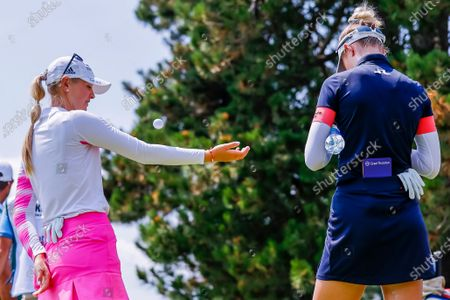 Jessica Korda (L) of the US juggles a ball while waiting with her sister Nelly Korda (R) of the US on the fourth hole during the first round of the Dow Great Lakes Bay Invitational women's golf tournament at the Midland Country Club in Midland, Michigan, USA, 14 July 2021.