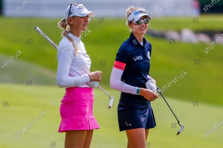 Sisters Jessica Korda (L) of the US and Nelly Korda (R) of the US on the fifteenth hole during the first round of the Dow Great Lakes Bay Invitational women's golf tournament at the Midland Country Club in Midland, Michigan, USA, 14 July 2021.