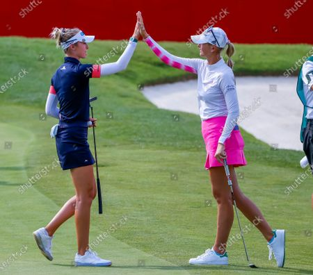 Sisters Nelly Korda (L) of the US and Jessica Korda (R) of the US react on the eighteenth hole during the first round of the Dow Great Lakes Bay Invitational women's golf tournament at the Midland Country Club in Midland, Michigan, USA, 14 July 2021.