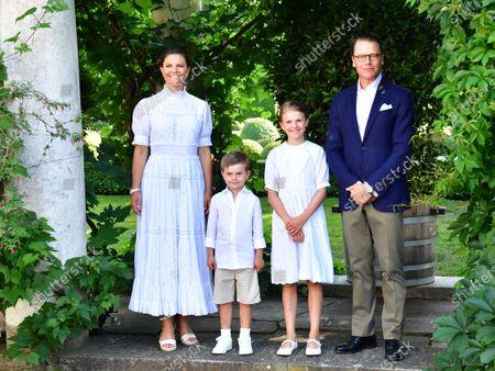 (L-R) Swedish Crown Princess Victoria, Prince Oscar, Princess Estelle and Prince Daniel pose for a family photo during Crown Princess Victoria's birthday celebrations at Solliden Palace in Borgholm, Sweden, 14 July 2021.