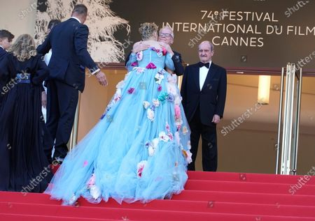 Stock Photo of Festival director Thierry Fremaux, center, embraces Sharon Stone as festival president Pierre Lescure, right, looks on at the premiere of the film 'The Story of My Wife' at the 74th international film festival, Cannes, southern France