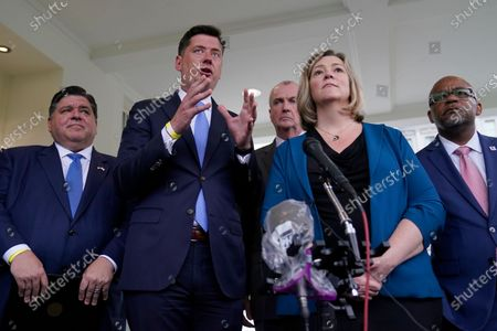 Stock Photo of Oklahoma City Mayor David Holt, second, from left, talks to reporters outside the West Wing of the White House in Washington, following a meeting with President Joe Biden to discuss the bipartisan infrastructure deal in the Senate. He is joined by, from left, Illinois Gov. JB Pritzker, New Jersey Gov. Phil Murphy, Dayton, Ohio Mayor Nan Whaley, and Denver Mayor Michael Hancock