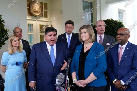 Illinois Gov. JB Pritzker, third from left, talks to reporters outside the West Wing of the White House in Washington, following a meeting with President Joe Biden to discuss the bipartisan infrastructure deal in the Senate. He is joined by, from left, Phoenix Mayor Kate Gallego, Mobile, Ala. Mayor Sandy Stimpson, Oklahoma City Mayor David Holt, Dayton, Ohio Mayor Nan Whaley, New Jersey Gov. Phil Murphy and Denver Mayor Michael Hancock