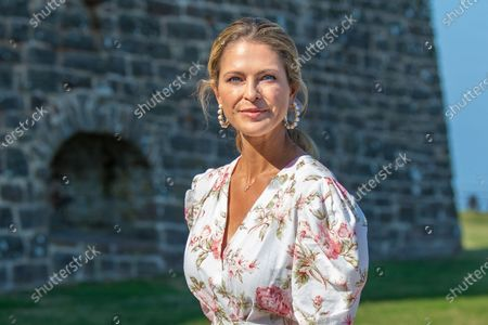 Stock Picture of Princess Madeleine during the festivities for the Crown Princess her 44th birthday at Borgholm's castle ruin, in Borgholm, Oland in Sweden.