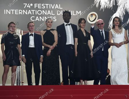 Lea Mysius, Celine Sciamma, Jehnny Beth, Lucie Zhand, Makita Samba, Jacques Audiard and Noemie Merlant  arrive for the screening of 'Paris 13th District' during the 74th annual Cannes Film Festival, in Cannes, France, 14 July 2021. The movie is presented in the Official Competition of the festival which runs from 06 to 17 July.