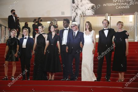 Lea Mysius, Celine Sciamma, Jehnny Beth, Lucie Zhand, Makita Samba, Jacques Audiard, Noemie Merlant, a guest and Valerie Schermann  arrive for the screening of 'Paris 13th District' during the 74th annual Cannes Film Festival, in Cannes, France, 14 July 2021. The movie is presented in the Official Competition of the festival which runs from 06 to 17 July.