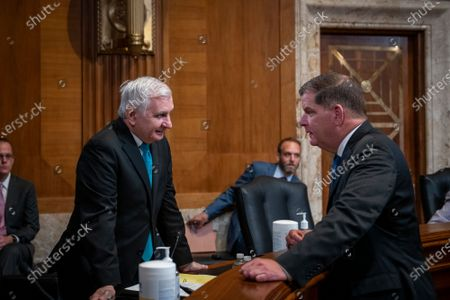 Stock Image of Department of Labor Secretary Martin J. Walsh, right, talks with United States Senator Jack Reed (Democrat of Rhode Island) prior to a Senate Committee on Appropriations - Subcommittee on Labor, Health and Human Services, and Education, and Related Agencies hearing to examine proposed budget estimates and justification for fiscal year 2022 for the Department of Labor, in the Dirksen Senate Office Building in Washington, DC,.