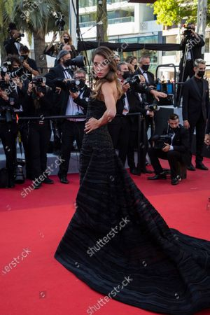 Elen Capri poses for photographers upon arrival at the premiere of the film 'The Story of My Wife' at the 74th international film festival, Cannes, southern France