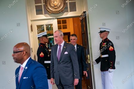 At left: Denver, Colorado Mayor Michael B. Hancock walks out of the West Wing with New Jersey Governor Phil Murphy (D-NJ), and Oklahoma City Mayor Michael B. Hancock, following a meeting at the White House in Washington, DC, on Wednesday, July 14, 2021. Senate Democrats on the Budget Committee agreed to set a $3.5 trillion top-line spending level for a bill to carry most of Biden's economic agenda into law without Republican support, bridging divisions among some party factions.