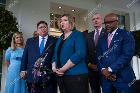 Stock Image of Dayton, Ohio Mayor Nan Whaley, center, speaks to journalists beside Illinois Governor J. B. Pritzker (D-IL), left, New Jersey Governor Phil Murphy (D-NJ), right, and Denver, Colorado Mayor Michael B. Hancock, far right, following a meeting at the White House in Washington, DC, on Wednesday, July 14, 2021. Senate Democrats on the Budget Committee agreed to set a $3.5 trillion top-line spending level for a bill to carry most of Biden's economic agenda into law without Republican support, bridging divisions among some party factions.