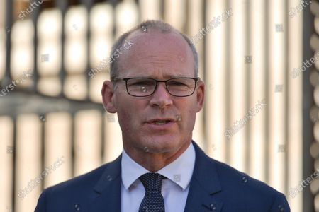 Simon Coveney, Minister for Foreign Affairs and Minister for Defence, speaks to the Media next to the entrance to Goverment Buildings. On Wednesday, 14 June 2021, in Dublin, Ireland.