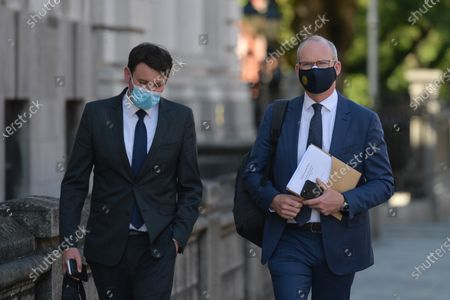 Simon Coveney (right), Minister for Foreign Affairs and Minister for Defence, on his way to Goverment Buildings. On Wednesday, 14 June 2021, in Dublin, Ireland.