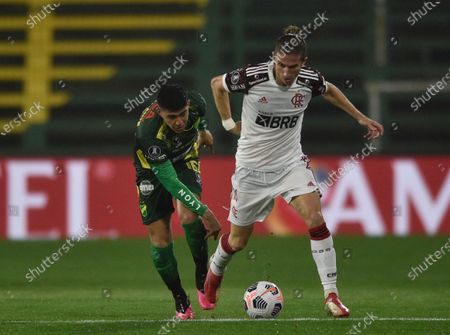 Filipe Luis of Brazil's Flamengo, right, and Lautaro Escalante of Argentina's Defensa y Justicia battle for the ball during a Copa Libertadores soccer match at Norberto Tomaghello stadium in Florencio Varela, on the outskirts of Buenos Aires, Argentina
