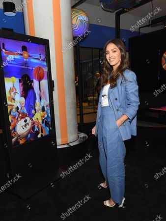 Stock Picture of Jessica Alba wears Brunello Cucinelli suit and Jimmy Choo shoes