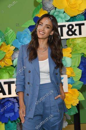 Jessica Alba wears Brunello Cucinelli suit and Jimmy Choo shoes