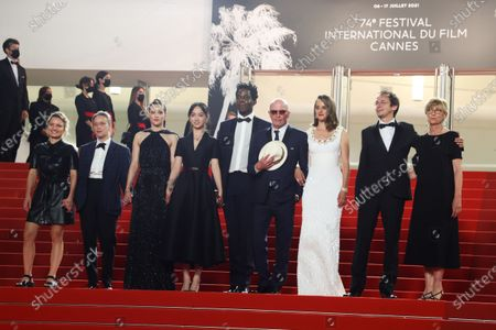 Stock Image of Lea Mysius, Celine Sciamma, Jehnny Beth, Lucie Zhang, Makita Samba, Jacques Audiard, Noemie Merlant, a guest and Valerie Schermann