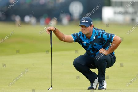 United States' Patrick Reed looks at the line of his putt on the 1st green during the first round British Open Golf Championship at Royal St George's golf course Sandwich, England
