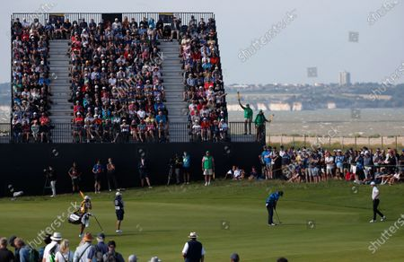 United States' Patrick Reed putt on the 7th green during the first round British Open Golf Championship at Royal St George's golf course Sandwich, England