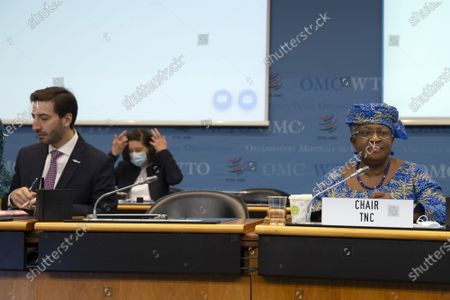 WTO Director-General Ngozi Okonjo-Iweala (R) and Colombia's Ambassador Santiago Wills (L), fisheries subsidies negotiations chair, attend a Fisheries Subsidies Meeting of the WTO Trade Negotiations Committee at Ministerial Level, at the headquarters of the World Trade Organization (WTO) in Geneva, Switzerland, 15 July 2021. A virtual meeting of ministers takes place on the day to advance negotiations on curbing harmful fisheries subsidies.