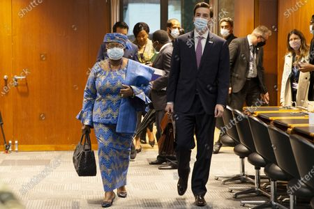 WTO Director-General Ngozi Okonjo-Iweala (L) and Colombia's Ambassador Santiago Wills (R), fisheries subsidies negotiations chair, arrive for a Fisheries Subsidies Meeting of the WTO Trade Negotiations Committee at Ministerial Level, at the headquarters of the World Trade Organization (WTO) in Geneva, Switzerland, 15 July 2021. A virtual meeting of ministers takes place on the day to advance negotiations on curbing harmful fisheries subsidies.
