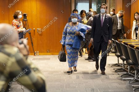 WTO Director-General Ngozi Okonjo-Iweala (C) and Colombia's Ambassador Santiago Wills (R), fisheries subsidies negotiations chair, arrive for a Fisheries Subsidies Meeting of the WTO Trade Negotiations Committee at Ministerial Level, at the headquarters of the World Trade Organization (WTO) in Geneva, Switzerland, 15 July 2021. A virtual meeting of ministers takes place on the day to advance negotiations on curbing harmful fisheries subsidies.