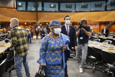 WTO Director-General Ngozi Okonjo-Iweala (C) and Colombia's Ambassador Santiago Wills (C-R, rear), fisheries subsidies negotiations chair, arrive for a Fisheries Subsidies Meeting of the WTO Trade Negotiations Committee at Ministerial Level, at the headquarters of the World Trade Organization (WTO) in Geneva, Switzerland, 15 July 2021. A virtual meeting of ministers takes place on the day to advance negotiations on curbing harmful fisheries subsidies.