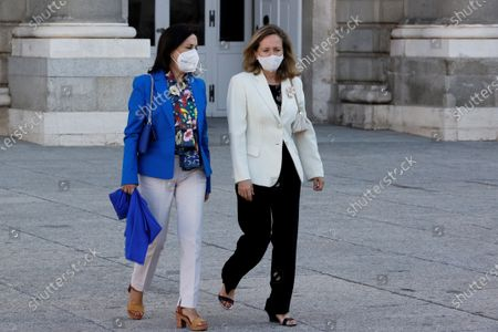 Spanish Defense Minister Margarita Robles (L) and First deputy Prime Minister and Economy Minister Nadia Calvino (R) attend the second official ceremony to pay tribute to the victims of the coronavirus disease (COVID-19) pandemic, at the Royal Palace, in Madrid, Spain, 15 July 2021. Spain's King Felipe VI and Queen Letizia chair the ceremony in memory of the victims of the infectious disease, especially recalling the health workers who died in one year and four months since the beginning of the pandemic.