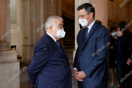 Stock Photo of Spanish Prime Minister Pedro Sanchez (R) chats with Spanish Constitutional Court President Juan Jose Gonzalez Rivas shortly before the beginning of the second official ceremony to pay tribute to the victims of the coronavirus disease (COVID-19) pandemic, at the Royal Palace, in Madrid, Spain, 15 July 2021. Spain's King Felipe VI and Queen Letizia chair the ceremony in memory of the victims of the infectious disease, especially recalling the health workers who died one year and four month since the beginning of the pandemic.
