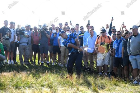 Patrick Reed of the US hits out of the rough on the seventh hole during the first round of The Open 2021 golf championship at Royal St George's golf course in Sandwich, Kent, Britain, 15 July 2021.